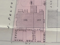 "Excerpt of a printed plan showing a semi-detached pair of houses labelled ""105"" and ""107"".  Each has a lawn with trees or bushes in front.  105 is substantially larger than 107."