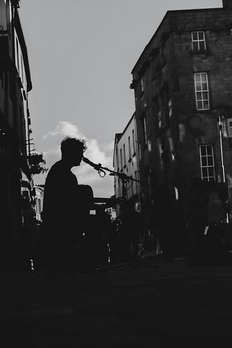 emeraldisle ireland northernireland acrossthepond fineartphotography landscape photography galway countygalway busker musician musicalbusker streetperformer streetsinger singer streetscene silhouette streetsilhouette performer streetphotography