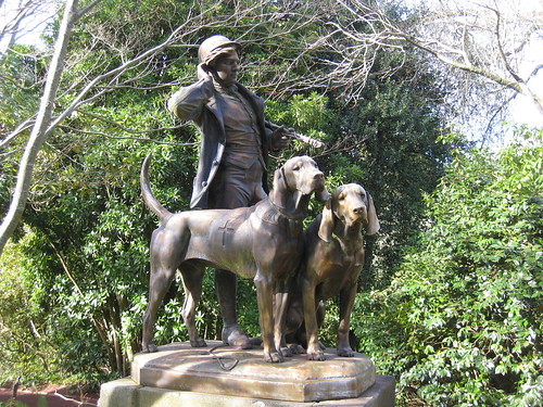 The Huntsman and Dogs Bronze Statue by Henri Alfred Jacquemart - the Forest Glade Gardens; Mount Macedon Road, Mount Macedon