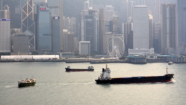 BOATS TRAVELLING IN (MISTY VICTORIA HARBOR),   HONG KONG,   SOUTH CHINA SEA. ( NOTE THE VICTORIA HARBOR FERRY...)