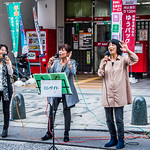 """2019 - Japan - Naha - J-Gospel Singers A trio of J-Gospel singers were giving it their all on Naha's Kokusai-dōri Street.  J-Gospel: J-Gospel is a Charismatic Church  in Naha.  A new group known as J-Gospel, is growing and spreading and beginning to exert influence similar to J-Pop and other forms of Japanese music that have taken Asia by storm.  According to Kaori Yamamoto one of the leading voices in the genre, """"J-Gospel"""" is in a sense a going back to our own roots.   Many people do not know that Gospel music has been sung in Japan for centuries, as far back as the first century when boatloads of refugees from the mainland came to Japan in search of freedom.  In particular, in the 17th century the music of Kirishtan was Japanese, indigenous and spread through the country, Yamamoto said.  Following World War II, American Gospel spread throughout Japan and in the early 90s there was a boom in Black Gospel Music which resulted in many choirs and even a television program on the main Government Channel.  Partly in reaction to that and partly in a going back to their roots in indigenous forms of the genre, Yamamoto and others are seeing the birth of a completely Japanese version.  """"Ranging from 'Ryukyu Gospel' with the haunting tones of Japan's southernmost Island, Okinawa to 'Enka Gospel' written in the traditional Japanese musical style, J-Gospel has spawned a weekly Radio Program, soon moving to TV,  live concerts throughout the country and its own label,"""" he said.  Japan's newest invention is seen by some experts as a possibility to finally revive the last time a Japanese song hit the pop charts of the world—in 1963 when the 'Sukiyaki Song' sung by Kyu Sakamoto hit number one on the US Charts. Yamamoto, Ikarashi and the other J-Gospel artists and their fans are convinced this can happen again.  m.youtube.com/watch?v=C35DrtPlUbc"""