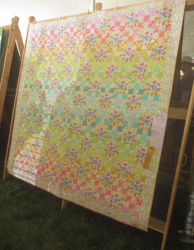 Quilt with light background and pastel squares