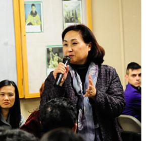 Miyong Kim at an East Austin gathering on community health