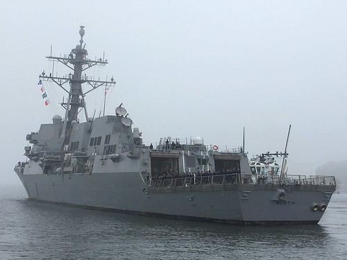 USS MUSTIN proceeding out to sea from Yokosuka Naval Base, Japan.