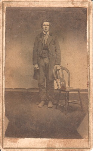 CDV_full-length portrait of man in a spare studio with bare wood plank floor, location unknown