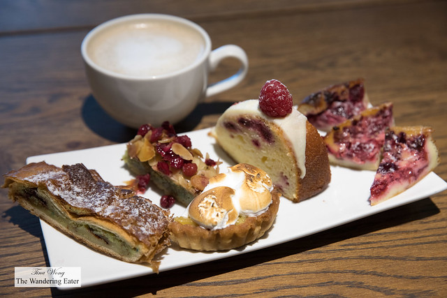 Sampler plate of sweets and latte