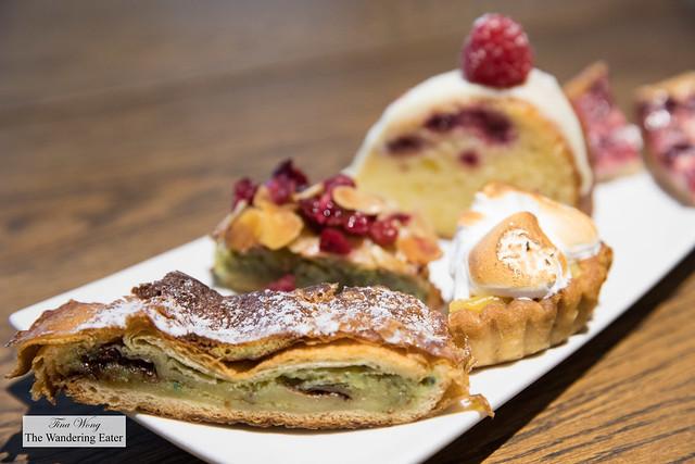 Sampler plate of sweets - pistachio raspberry croissant, lemon meringue tart, cranberry almond financier