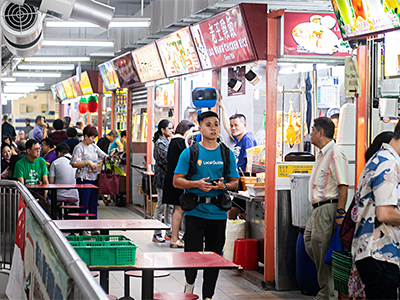 Google's Street View Trekker in action at Chinatown Market in Singapore.