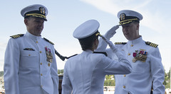 Capt. Kevin P. Lenox salutes Rear Adm. Yvette M. Davids, commander of Carrier Strike Group 11, as he turns over command of USS Nimitz (CVN 68) to Capt. Max Clark, Aug. 1. (U.S. Navy/MC2 Donald R. White Jr.)