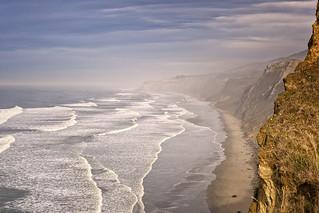 Early morning Sea Mist lifting at Mackintoshes Beach, North Canterbury, South Island, New Zealand.