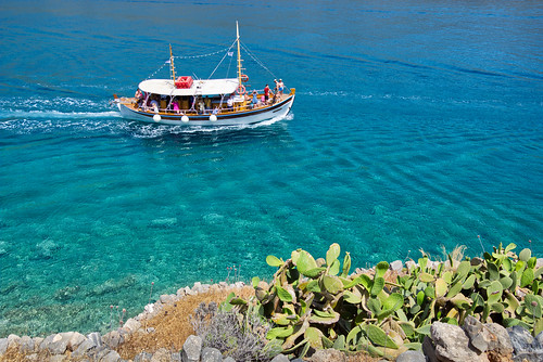 Tourist boat in front of the island Spinalonga