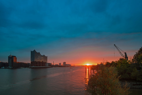 sky sunrise sun sunlight hamburg river elbphilharmonie colours nikon outside reflection travel outdoors tourism clouds cityscape