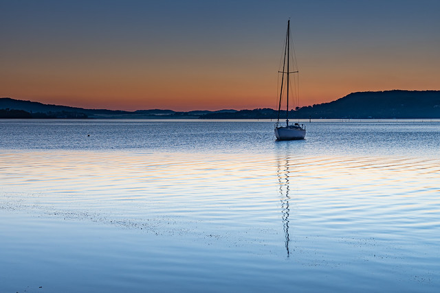 Clear Skies a boat and a Winters Dawn by the Bay