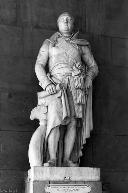 Statue of Admiral comte Pierre André de Suffren de Saint Tropez is one of the artwork in the interior of Versailles, France-78