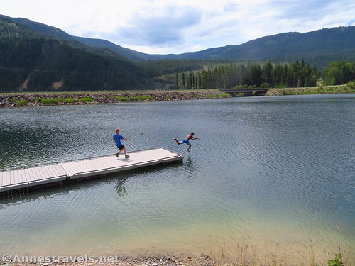 Swimming at the boat launch on the Bull River, Cabinet Mountains, Montana