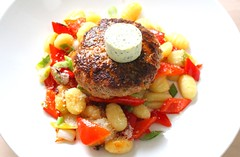 GERMAN VEAL-BURGER WITH GARLIC/HERB BUTTER, GNOCCHI, PEPPERS & ONIONS