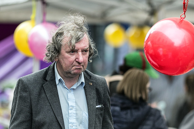 A man and a red balloon