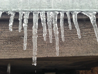 Icicles hanging from the eve of a house