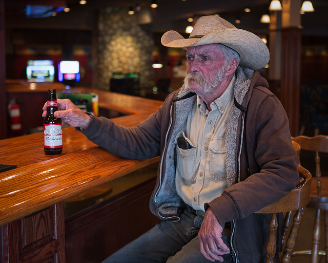 Cowboy with beer. Southern Alberta