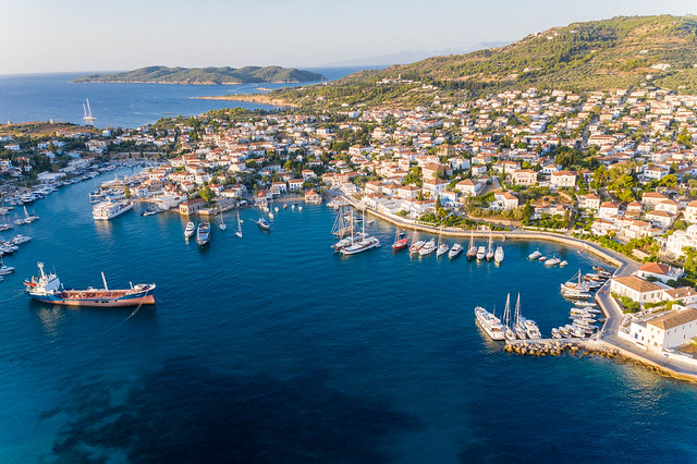Aerial view of boats and a cargo ship in a port between Agios Mamas and Agios Nikolaos, on the Greek island Spetses in the Argolic Gulf