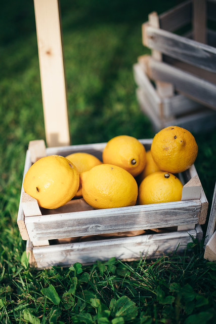 Lemons in a basket on the grass