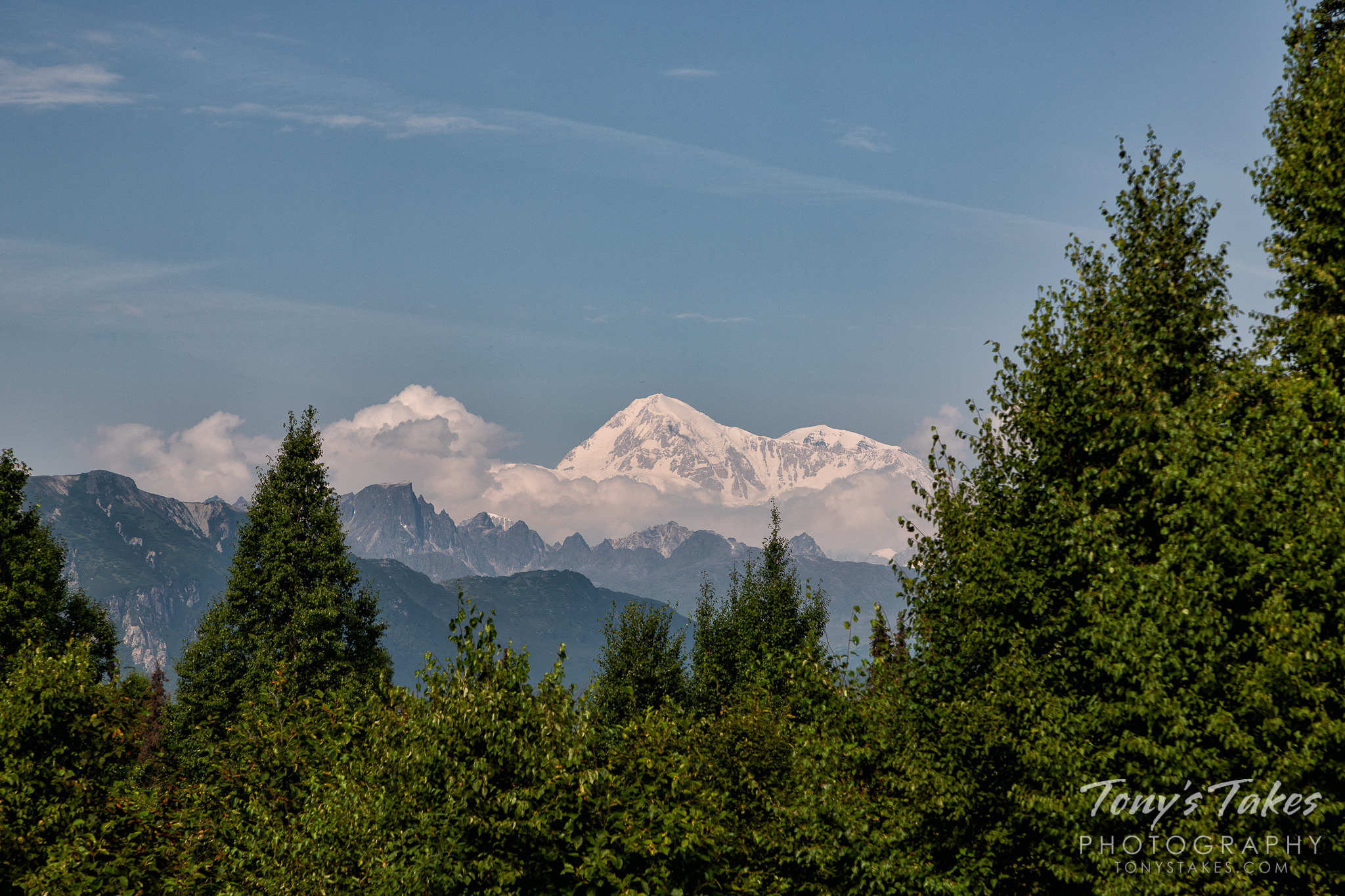 Denali stands tall and proud above the surrounding landscape in Alaska. (© Tony's Takes)