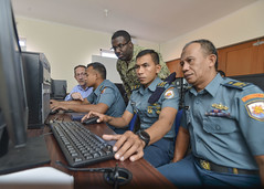 U.S. Navy Intelligence Specialist 1st Class Rodney Franklin, center, a maritime domain awareness analyst, monitors a CENTRIXS (Combined Enterprise Regional Information Exchange System) terminal alongside Indonesian Navy sailors during CARAT Indonesia. (U.S. Navy/ MC1 Greg Johnson)