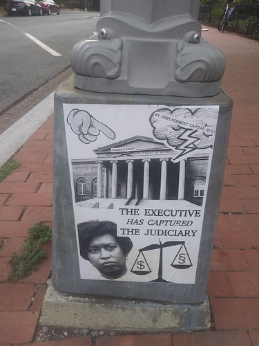 "Protest poster on recent court decision concerning zoning, featuring Mayor Muriel Bowser, and the line ""The Executive has captured the Judiciary"""