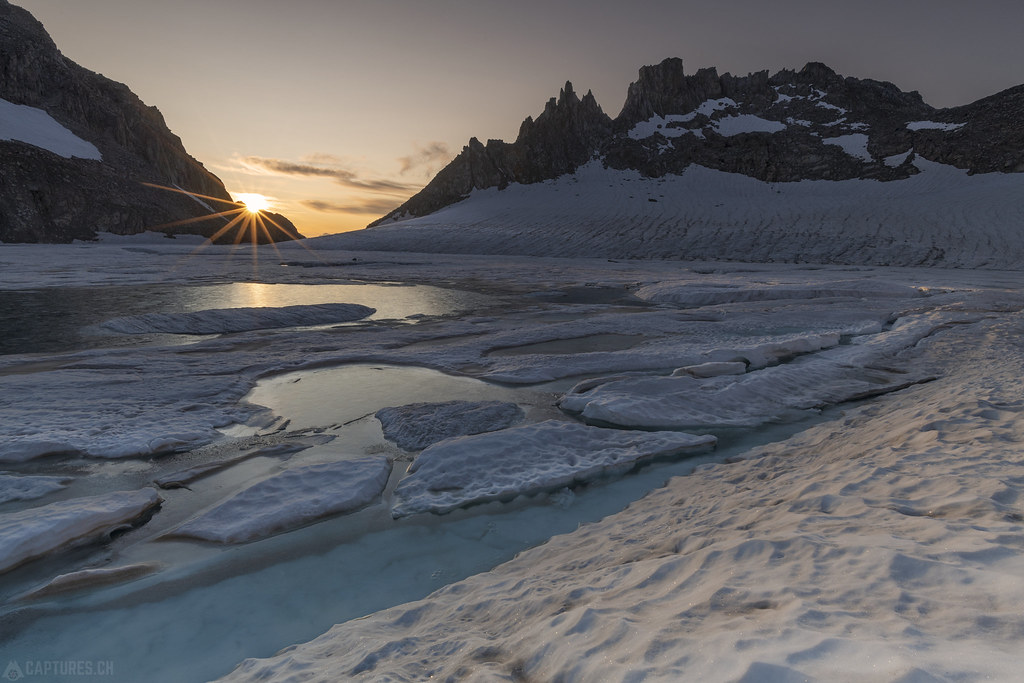 Blue ice lake in the first sun rays - Gerenpass