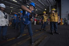 Sailors aboard USS Ronald Reagan (CVN 76) handle line during a replenishment-at-sea with USNS Walter S. Diehl (T-AO 193), Aug. 1. (U.S. Navy/MC2 Tyra M. Campbell)