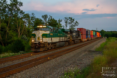 es44ac trees doublestacks train21v 8099 ns heritage norfolksouthern train macedonia ohio unitedstatesofamerica