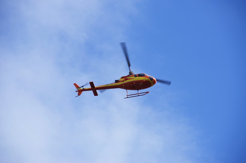 Mountain rescue helicopter hovering in the air (3)