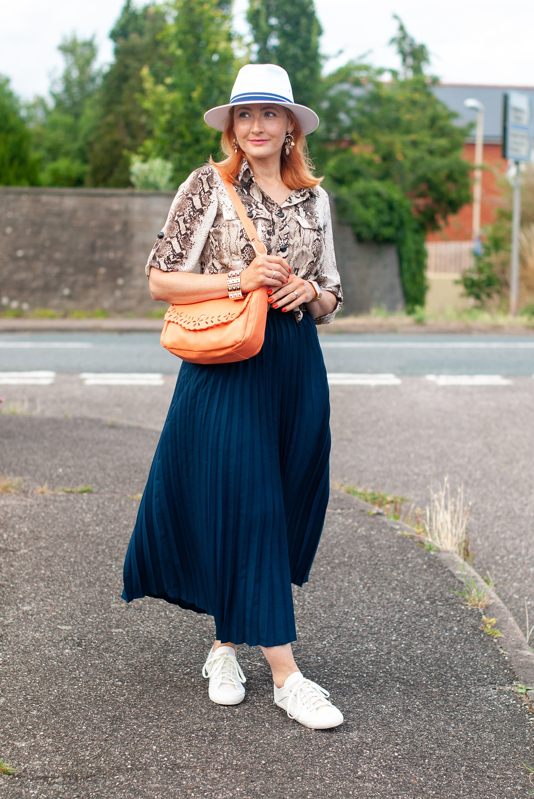Why a Pleated Maxi With Sneaks is a Failsafe Summer Outfit \ snakeskin print shirt \ navy pleated maxi skirt \ white fedora \ white sneaks \ orange shoulder bag | Not Dressed As Lamb, over 40 fashion