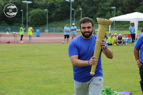 Participant taking the NYS Torch round the ground