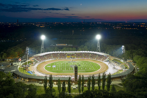 wrocław lowersilesianvoivodeship poland no people outdoors city high angle view architecture cityscape illuminated stadium aerial building exterior night famous place travel destinations tree built structure lights sunset sunrise sport speedway wroclaw poladn drone photo from above motorsport europe olympic illumination