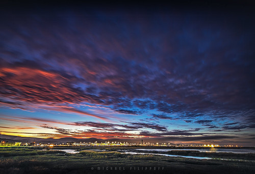 sunset sanfrancisco airport sfo water clouds colorful reflection surreal shimmering blue orange shoreline lowtide
