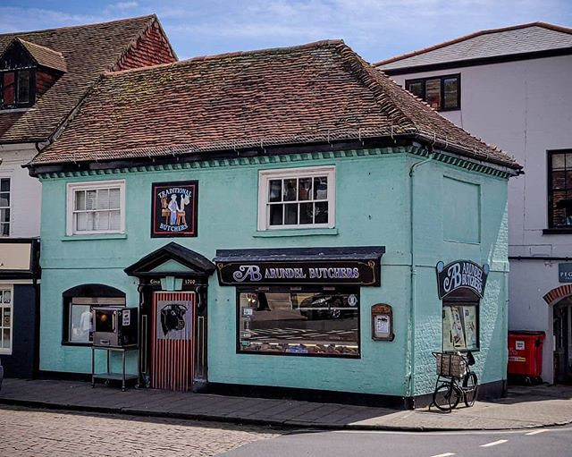 On my visit to Arundel I went past this old fashioned butchers, What a nice old building also nice to see the butcher doing his work from the window unlike the main stream shops you don't see where your food comes from. · · · · · #village #butchershop #vi