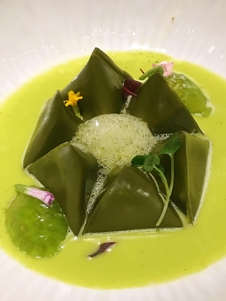 Berlingots: Matcha pasta parcels with a French cheese fondue centre, green zebra tomato and herb of grace consommé, fresh verbena