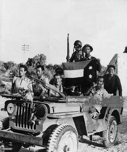 FM-24-29-jeep-54btn-with-iraqi-flag-after-capture-of-nazareth-194807-gty-1