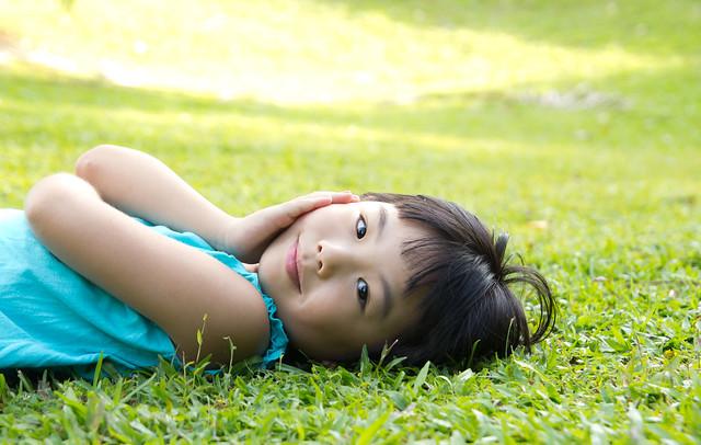 Child lying on grass