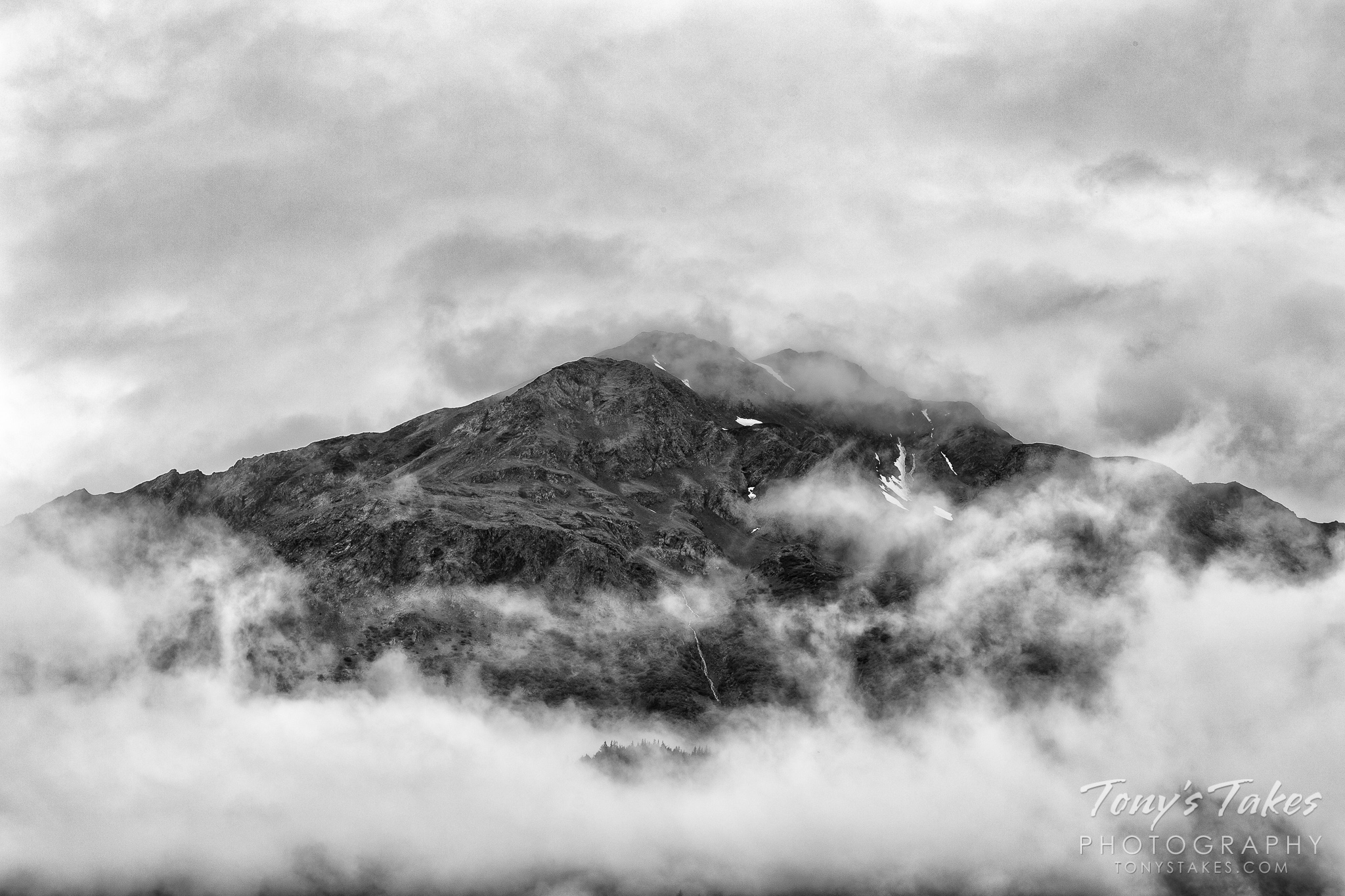 Clouds ring around a mountain near Seward, Alaska. (© Tony's Takes)