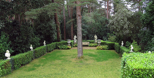 A grassy area lined with statues in the castle garden in Glenveagh National Park in Ireland