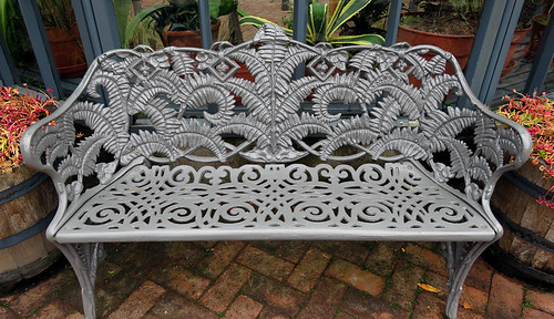 A bench in the castle garden in Glenveagh National Park in Ireland