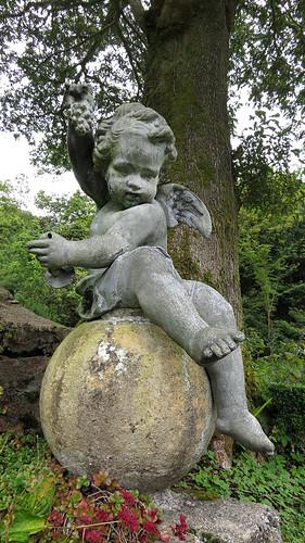 A cherub sculpture in the castle garden in Glenveagh National Park in Ireland