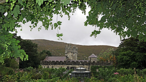 A view of the Castle through the hops in the castle garden in Glenveagh National Park in Ireland