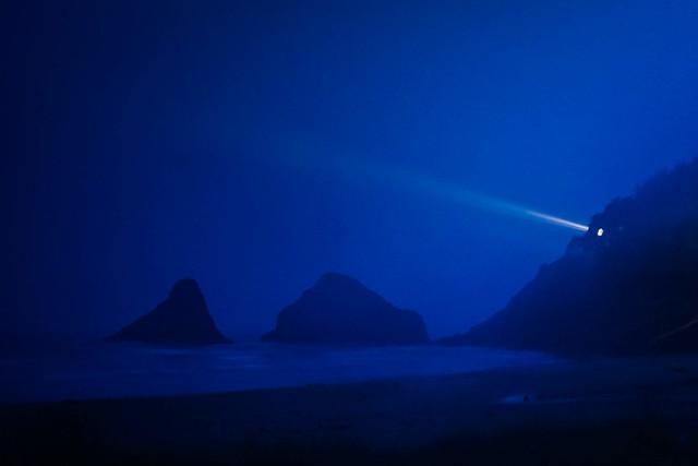 A light in the foggy, rainy night