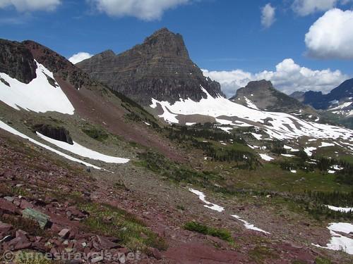 Walking back toward the Hidden Lake Trail along the Mount Reynolds Trail in Glacier National Park, Montana