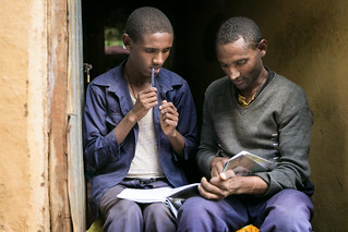 Special needs student Chalachew Tesfane does homework with his father | by Global Partnership for Education - GPE