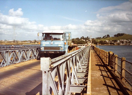 <p>On 16 August the first of several public open days will be held to show local communities what the new Mangere Bridge will look like.  This will be the replacement for the bridge that was closed on 25 November 2018, after being used as a footpath and cycleway for about 35  years after the opening of the current motorway bridge in 1983.   <br /> <br /> Although the new bridge has a walkway and cyclepath underneath it, the old bridge continued to be used as a walking and cycling link between Onehunga and Mangere Bridge, and it had also become a popular fishing spot.<br /> <br /> This photo shows the old bridge when it was carrying motor traffic, from a Ministry of Works photograph c.1980, held in Auckland Regional Office - <br /> <br /> Archives New Zealand reference - ZZZZ A1671/1/a<br /> <br /> Material from Archives New Zealand Te Rua Mahara o te Kāwanatanga</p>