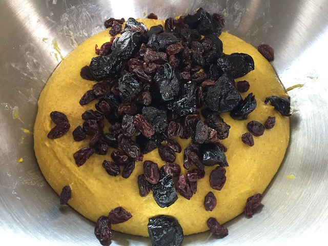 Mixing dried plums and raisins